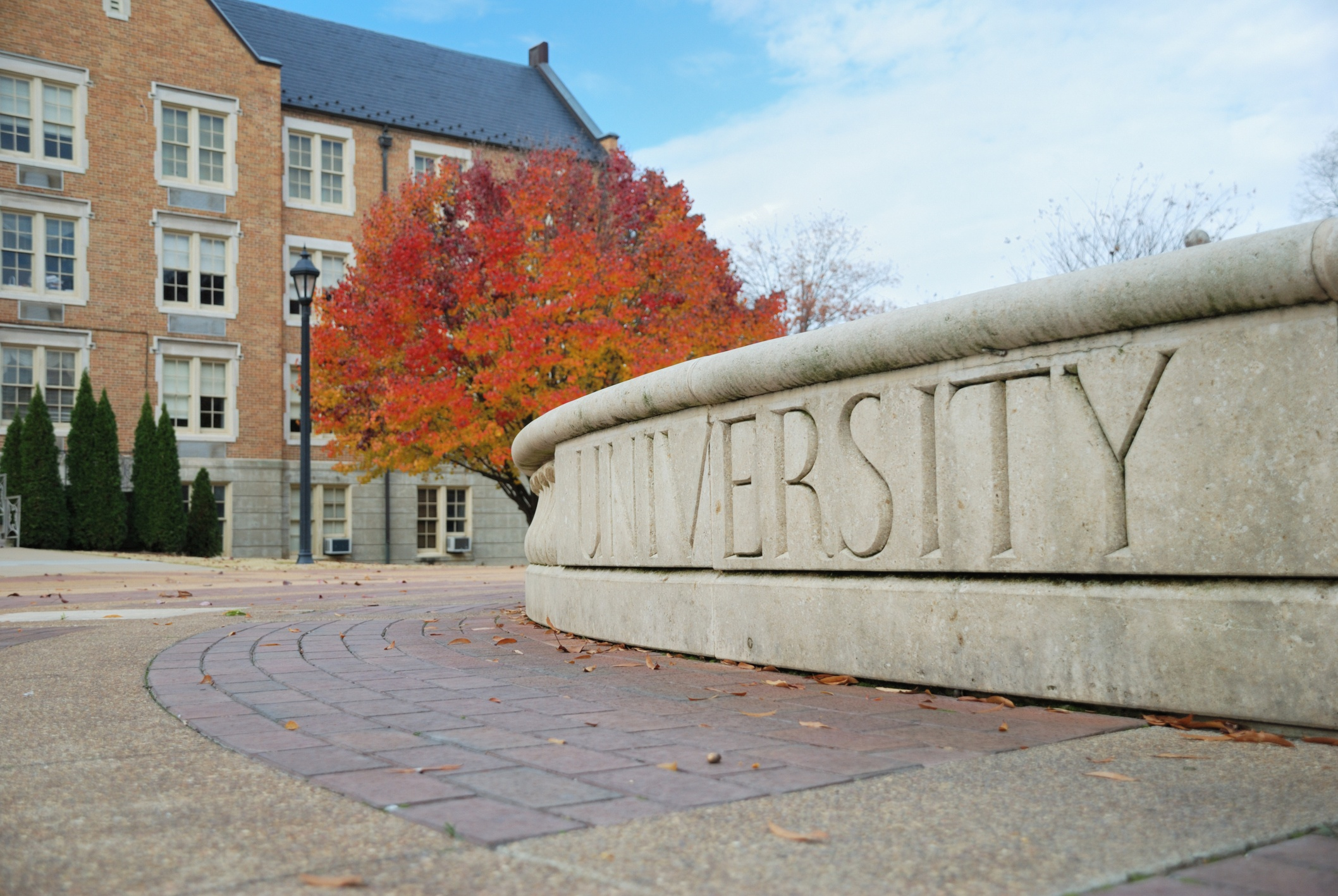 University Sign Made Out of Stone